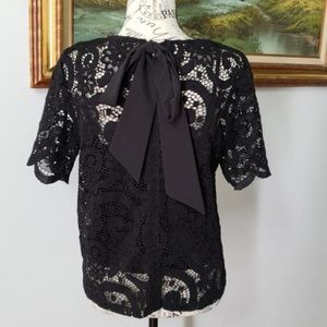 Nanette Lepore Tops - Nanette Lepore black lace crochet blouse